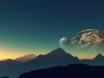 planets behind the mountain peaks