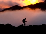 woman hiker in mt. rainier park at sunset
