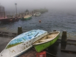 lonely boats on a foggy harbor in hakone japan