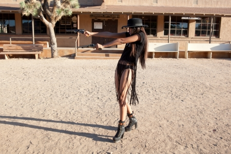 ~Cowgirl~ - cowgirl, town, stores, hat, building, brunette, guns, tree, sand, benches