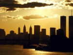 silhouettes of twin towers in nyc at sunset