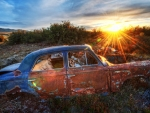 old rusted wreck of a car at sunrise hdr