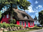 red house with thatched roof in germany