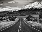 blacktop road to a mountain lake in new zealand hdr
