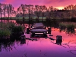 broken pier on a beautiful purple lake hdr