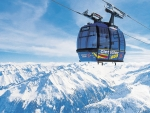 ski lift gondola above the mountains
