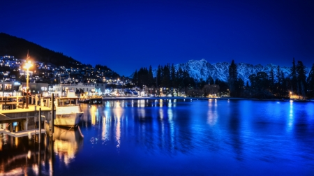 lakeside town on a blue night - boats, mountains, town, lake, docks, blue, night