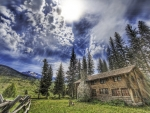 sunbeams over lovely log cabin hdr