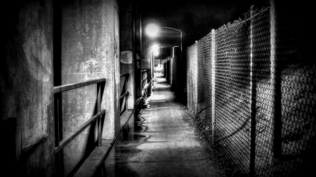wire fence at an underpass - walkway, wire, underpass, fwnce, lights, BW
