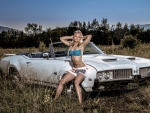Model and her Oldsmobile 442