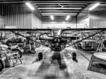 plane and motorcycles in a hanger hdr