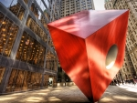 red modern sculpture in downtown manhatten hdr