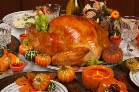 Thanksgiving Dinner - dinner, centerpiece, glasses, plates, Holiday, candles, mashed potatoes, potatoes, leaves, Thanksgiving, turkey, pumpkins