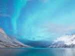 Aurora Borealis above the snowy mountains