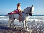 Cowgirl On The Beach