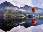 hot air balloon over crystal clear lake