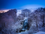 beautiful winter waterfall in auvergne france