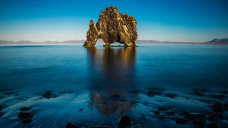 wondrous rock formation off hvitserkur iceland - shore, rock, formation, mountains, sky, sea