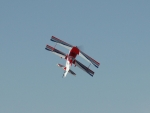 RC biplane climbs and turns