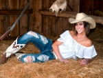 Cowgirl in Her Barn