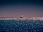 sailboat on a shimmering sea