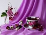 Cup of tea in purple background