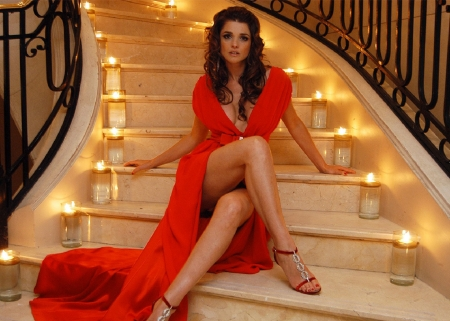 Araceli Gonzalez  Stunning in red - Brunette, red dress, illuminated stair case, earrings, sitting on stairs, heels