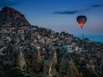 Hot air balloon over Uçhisar in Cappadocia Turkey