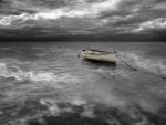 boat in a black and white stormy sea