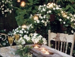 Candles and vine under rose arch