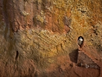 Woman emerges from a tunnel leading to Bet Amanuel in Lalibela Ethiopia