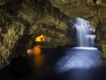 waterfall inside a cavern in scotland