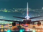 plane taking off into colorful lights