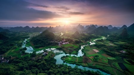 panorama of a fertile river valley in china - mountains, fields, river, sunset, valley