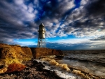 little metal lighthouse on england coast hdr