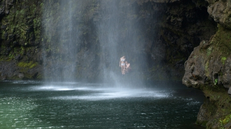 couple behind a waterfall - rocks, waterfall, pool, couple, cave