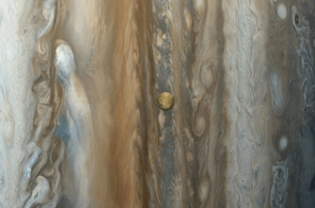 Io over Jupiter from Voyager - jupiter, moon, cool, planet, io, space, fun