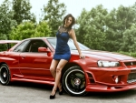 Red Nissan Skyline R34 and a Model
