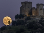 Supermoon rises behind Almodovar Castle, 13 November, 2016