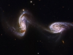 Arp 240 A Bridge between Spiral Galaxies from Hubble