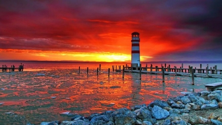 Lighthouse Sunset - sun, pier, sunset, sky, lighthouse, sea, water, stone, nature