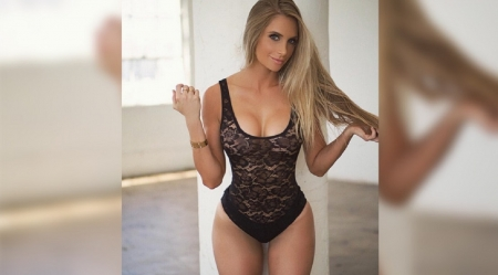 Amanda Lee - black lace teddy, gold wrist band, blonde, smooth straight hair, faded image