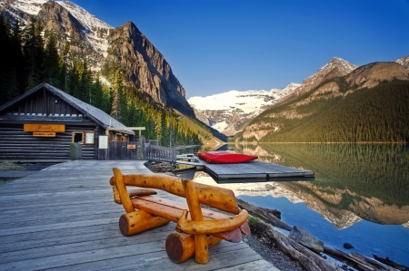 Tranquil mountain lake - hills, rest, house, view, bench, canoes, beautiful, cabin, sky, lake, mountain, tranquil, dock, serenity