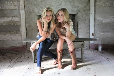 Cowgirls Maddie and Tae - guitarists, Maddie, floor, boots, songwriters, bench, wall, Taylor Dye, singers, wood floor, cowgirls, Madison Marlow, Tae, blondes, wood