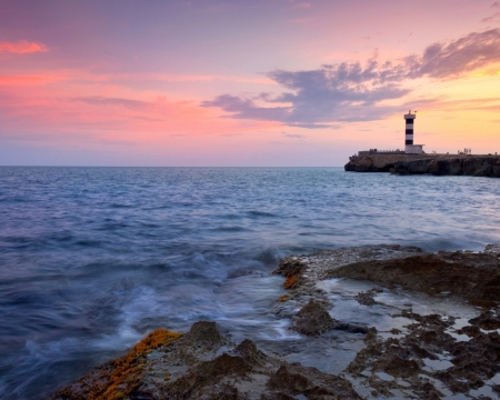 Lighthouse at Sunset - stone, nature, sunset, clouds, lighthouse, sea, landscape