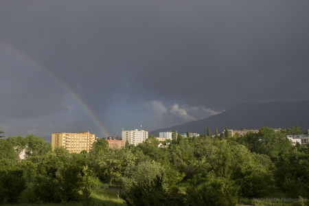 Rainbow - photo, beautiful, rainbow, trees, sky, clouds, weather, photography, city, dark, nature