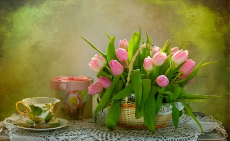 Tea and Tulips - table, present, ribbon, box, bow, gift, still life, doilies, basket, cup, tulips