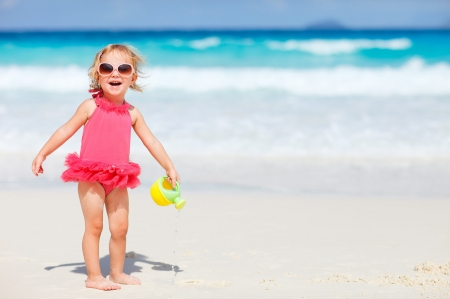 Little girl on the beach - little, sea, sunglasses, beach, sand, girl, summer, copil, child, pink, blue