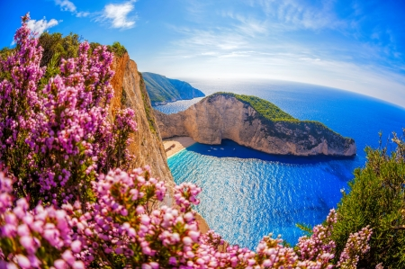 Navagio bay-Greece - rocks, view, Navagio, beautiful, sky, sea, beach, Greece, Zakynthos, paradise, wildflowers, summer, horizons, bay, coast