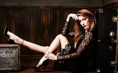 Katie Cassidy - posing on floor, blace lace dress, tattoo right leg, ring on left hand, travel trunk, wood panels